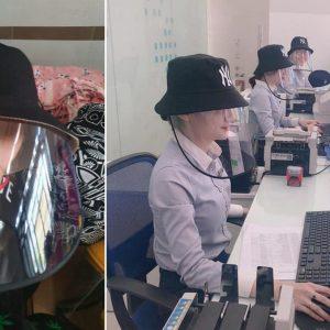 nhân viên ngân hàng sử dụng mũ nón chống dịch giọt bắn